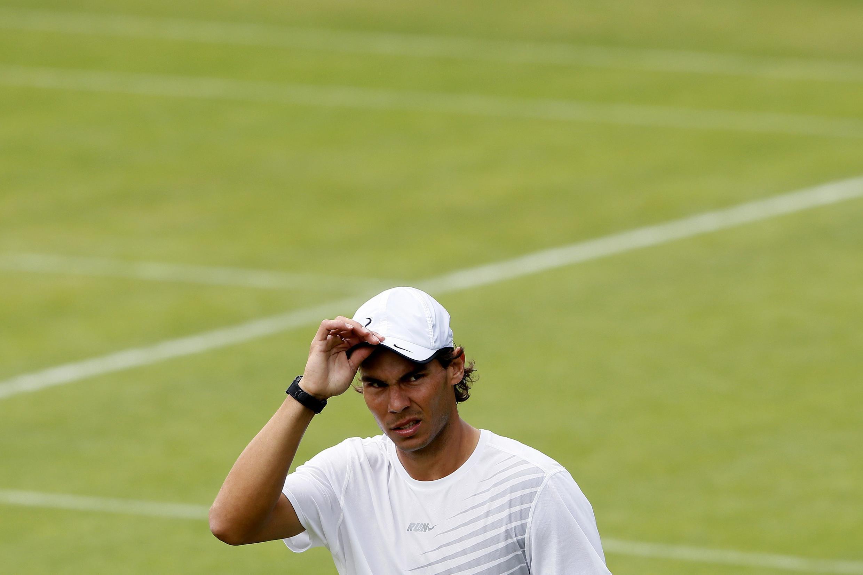 Rafael Nadal a lokacin da ya sha kashi a Wimbledon.