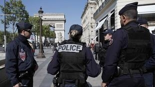 French CRS police patrol the Champs Elysees Avenue the day after a policeman was killed and two others were wounded in a shooting incident in Paris, France, April 21, 2017.