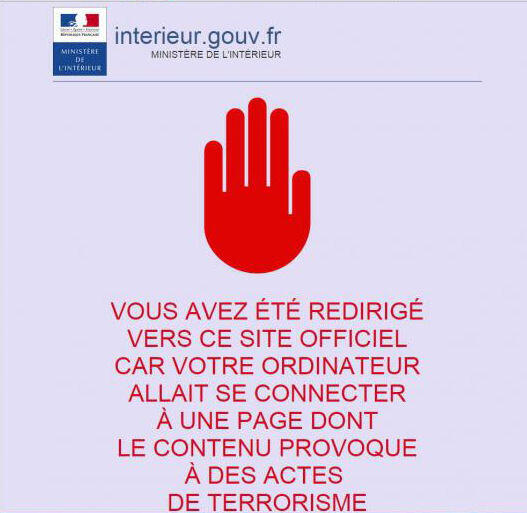 """Hình ảnh hiện lên khi truy cập một trang web cổ vũ khủng bố tại Pháp. Dòng chữ bên dưới:""""Bạn được dẫn về trang web chính thức này vì máy tính bạn kết nối với một trang có nội dung cổ vũ khủng bố""""."""