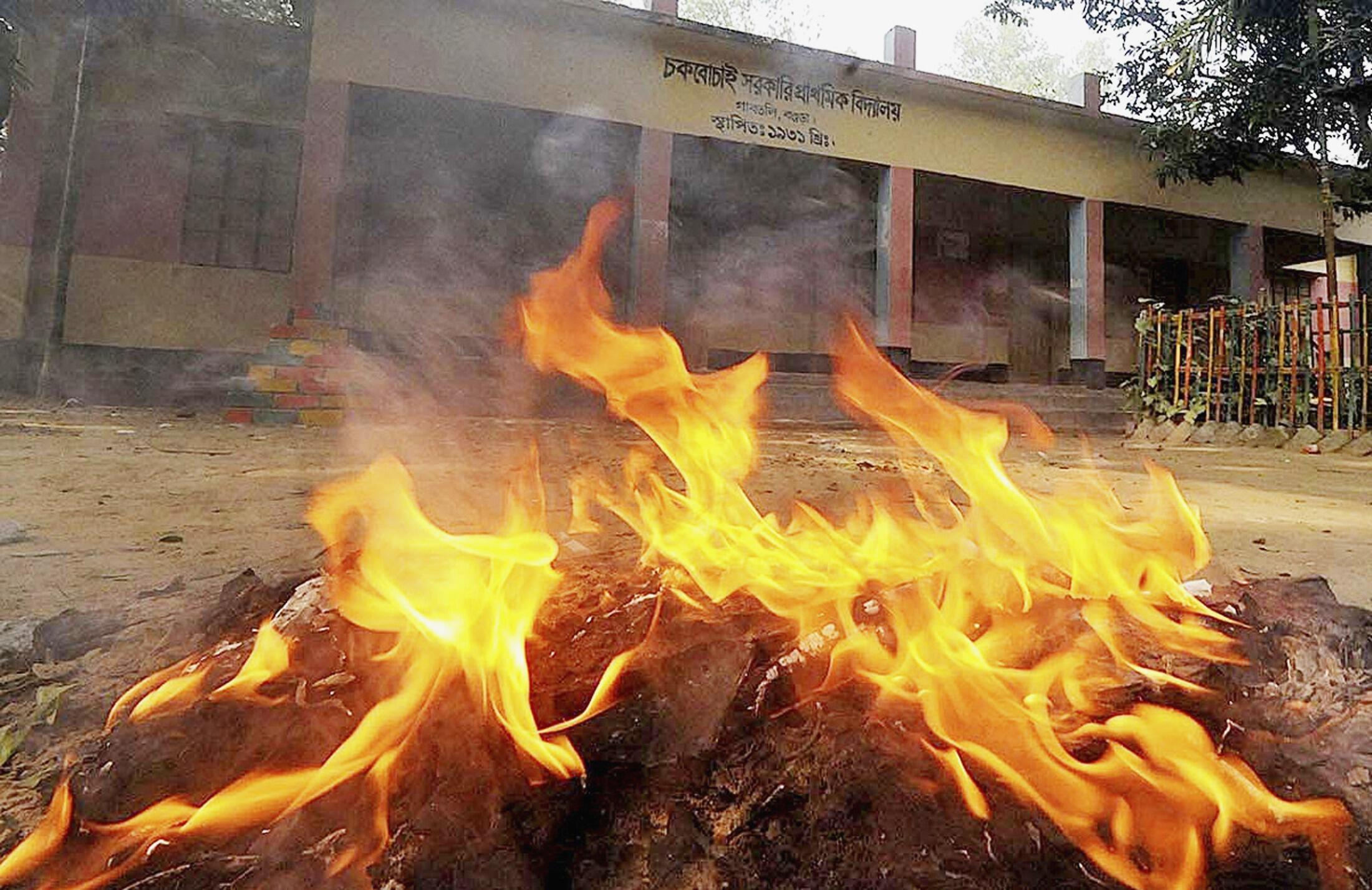 Election materials are set ablaze in front of a polling booth after an attack by protesters in Bogra January 5, 2014
