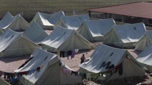 Des réfugiés syriens installés dans la plaine de la Bekaa, au nord du Liban, le 27 décembre 2012.