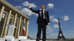 Nicolas Sarkozy waves to supporters as he arrives at Trocadéro
