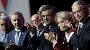 Francois Fillon (C), former French prime minister, member of The Republicans political party and 2017 presidential election candidate of the French centre-right, applauds at a campaign rally in Margny-les-Compiegne, France, February 15, 2017.