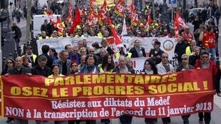 Trade unionists protest against the law in Marseille on Tuesday