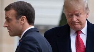 US President Donald Trump (R) is welcomed by French president Emmanuel Macron prior to their meeting at the Elysee Palace in Paris, on November 10, 2018, on the sidelines of commemorations marking the 100th anniversary of the 11 November 1918 armistice, en