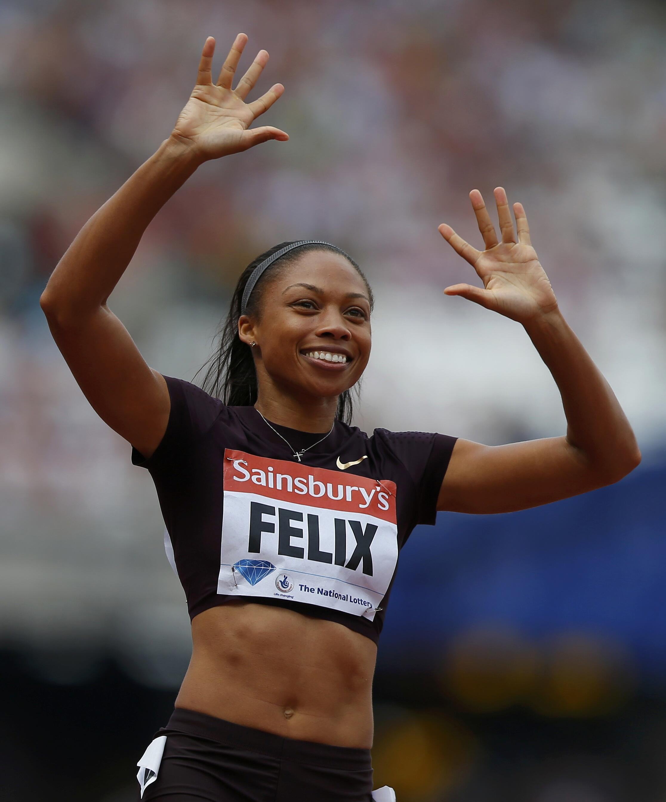 Allyson Felix of the U.S. reacts after winning the women's 200m at the London Diamond League 'Anniversary Games' athletics meeting at the Olympic Stadium, in east London July 27, 2013.