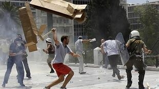 Protesters clash with police in Athens, 29 June 2010.