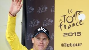 Froome wears the race leader's yellow jersey after the 11th stage from Pau to Cauterets, 15 July 2015