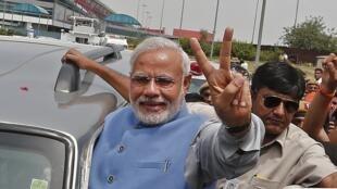 Novo premiê, Narendra Modi saiu às ruas de Nova Déli para comemorar a vitória nas urnas.