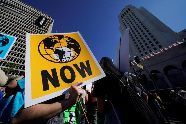 A person holds a placard during a march and rally at the Youth Climate Strike in Los Angeles, California, U.S., November 1, 2019.