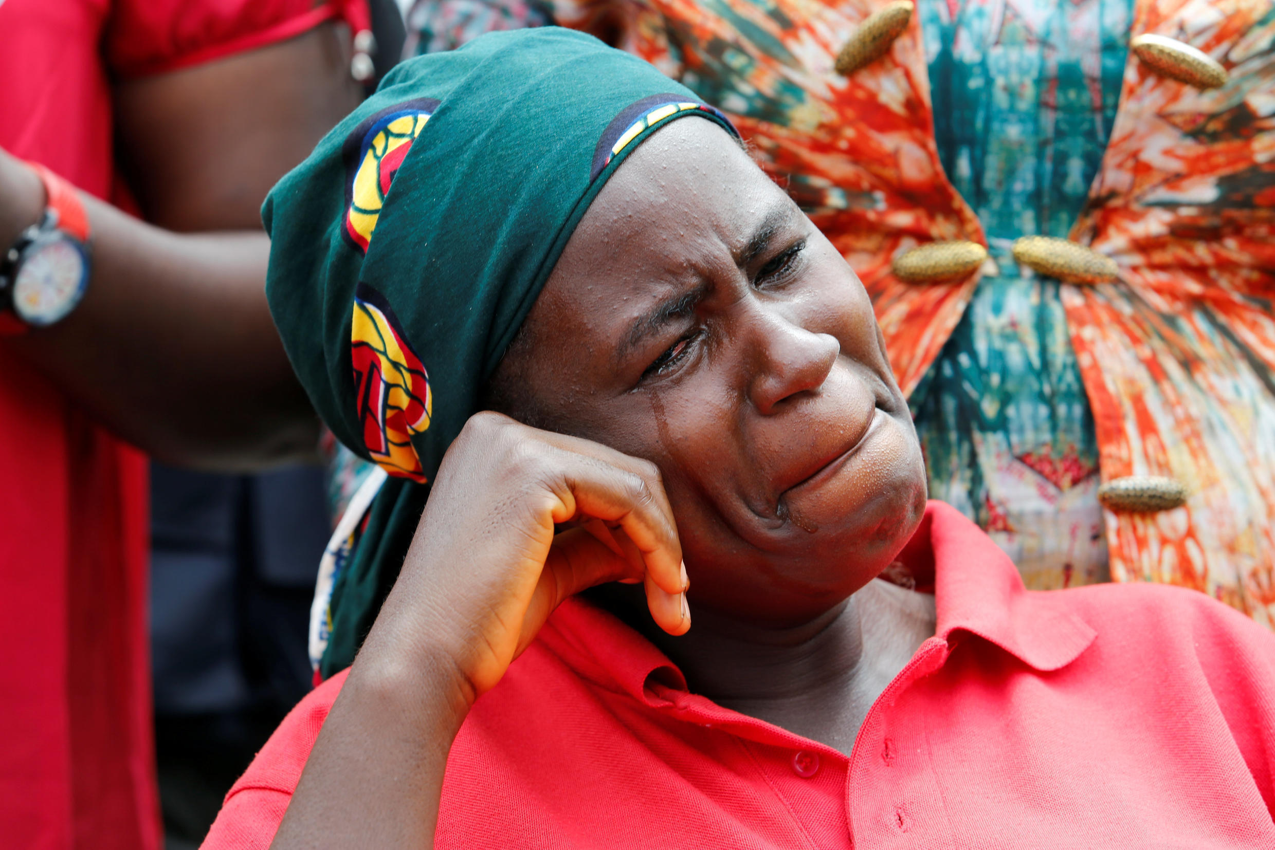 A parent of one of the abducted Chibok school girls cries after the police prevented the parents access to see President Muhammadu Buhari during a rally in Abuja, Nigeria August 25, 2016.