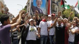 Des partisans du président Bachar el-Assad, à Damas, le 3 juin 2014.