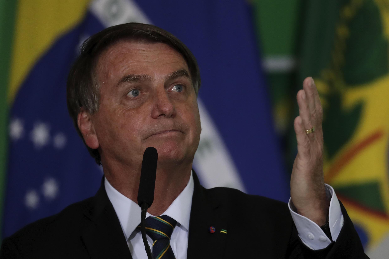 Le président brésilien Jair Bolsonaro s'est de nouveau prononcé contre le port du masque, provoquant un nouveau tollé, lors d'une allocution à Brasilia, le 10 juin 2021.