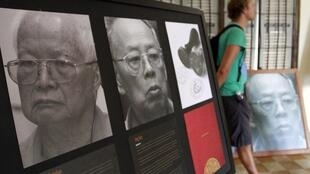 Portraits of former Khmer Rouge president (l) and former minister Ieng Sary (r) at the genocide museum in Phnom Penh