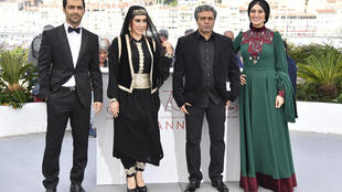 Iranian actor Reza Akhlaghirad, Iranian actress Nasim Adabi, Iranian director Mohammad Rasoulof and Iranian actress Soudabeh Beizaee pose on May 19, 2017 during a photocall for the film 'Lerd' (A Man of Integrity) at the 70th  Cannes Film Festival.