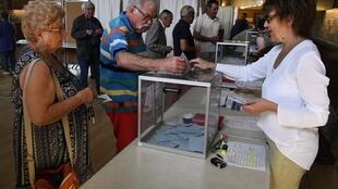 A man casts his vote at a polling station in Carhaix-Plouguer, western France, during the second round of the French parliamentary elections (elections legislatives in French) on June 18, 2017.