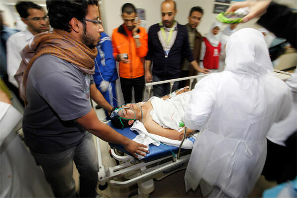 An injured protester is rushed to the operation theatre in a hospital in Manama on 17 February, 2011