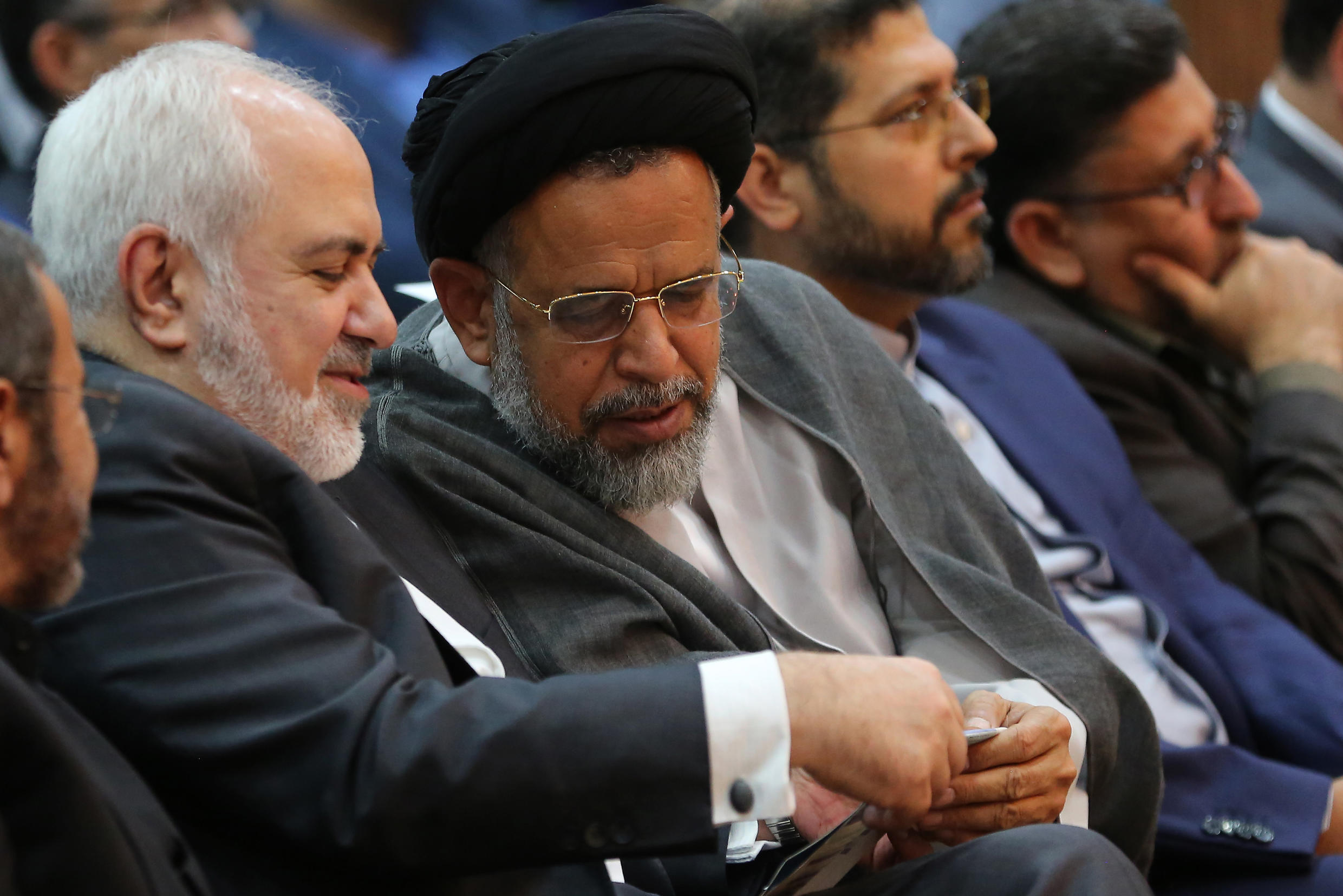 Iran's Intelligence Minister Seyyed Mahmoud Alavi (2-L) shares a word with Foreign Minister Mohammad Javad Zarif  at a conference in Tehran in October 2019