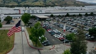 Workers at Tesla's factory in Alameda County in California have been exempted from a new curfew because they are deemed essential