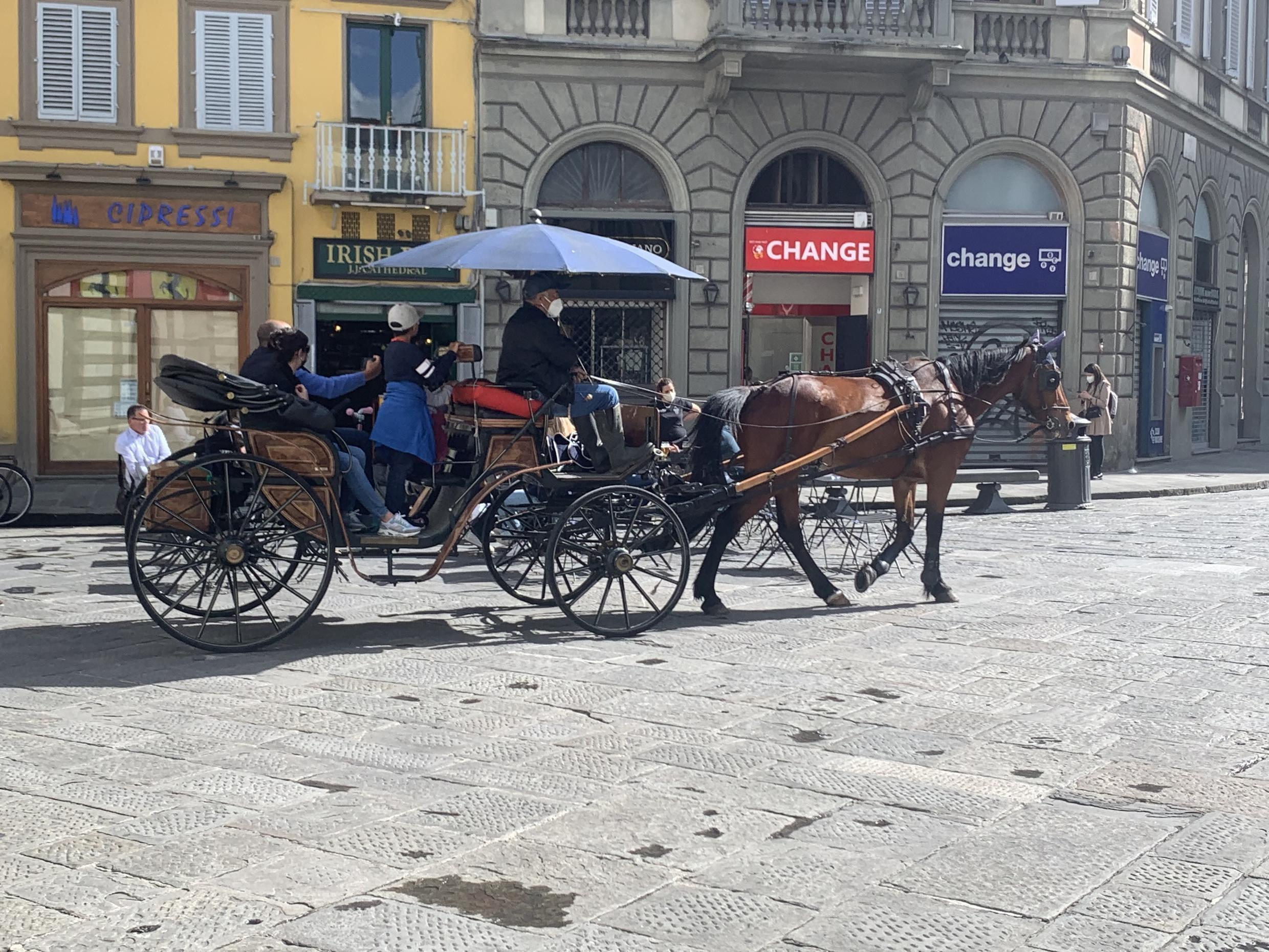 Tourists taking a ride with a horse and carriage in the streets of Florence, Italy, May 2021. The country is hoping to see an influx of foreign tourists this summer as Covid restrictions are lifted.
