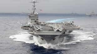 USS George Washington aircraft carrier participating in a naval exercise