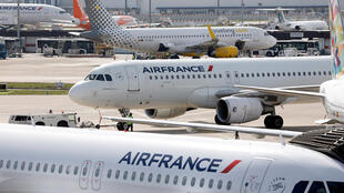 Air France passenger jets are seen on the tarmac of Orly Airport, near Paris, on the eve of a one-day strike over salaries by Air France pilots, cabin and ground crew unions, France, March 21, 2018.
