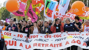 Demonstrators protest pension reform in Toulouse on October 2