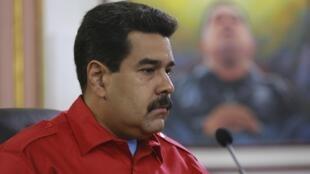 El Presidente de Venezuela, Nicolás Maduro, durante su entrevista con la oposición en abril de 2014.