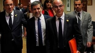 Jailed Catalan politicians Jordi Turull, Jordi Sanchez and Jordi Turull leave after getting their parliamentary credentials at Spanish Parliament, in Madrid, Spain, 20 May, 2019.