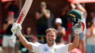 South African batsman AB de Villiers celebrates after scoring a century against Australia.
