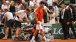 O mau tempo interrompeu a semifina entre Andy Murray e Novak Djokovic.
