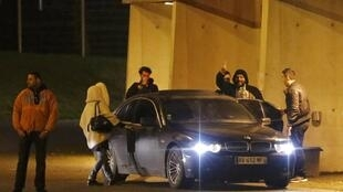 French humorist Dieudonne M'bala M'bala (2ndR) waves to fans as he leaves the Zenith concert hall in Nantes