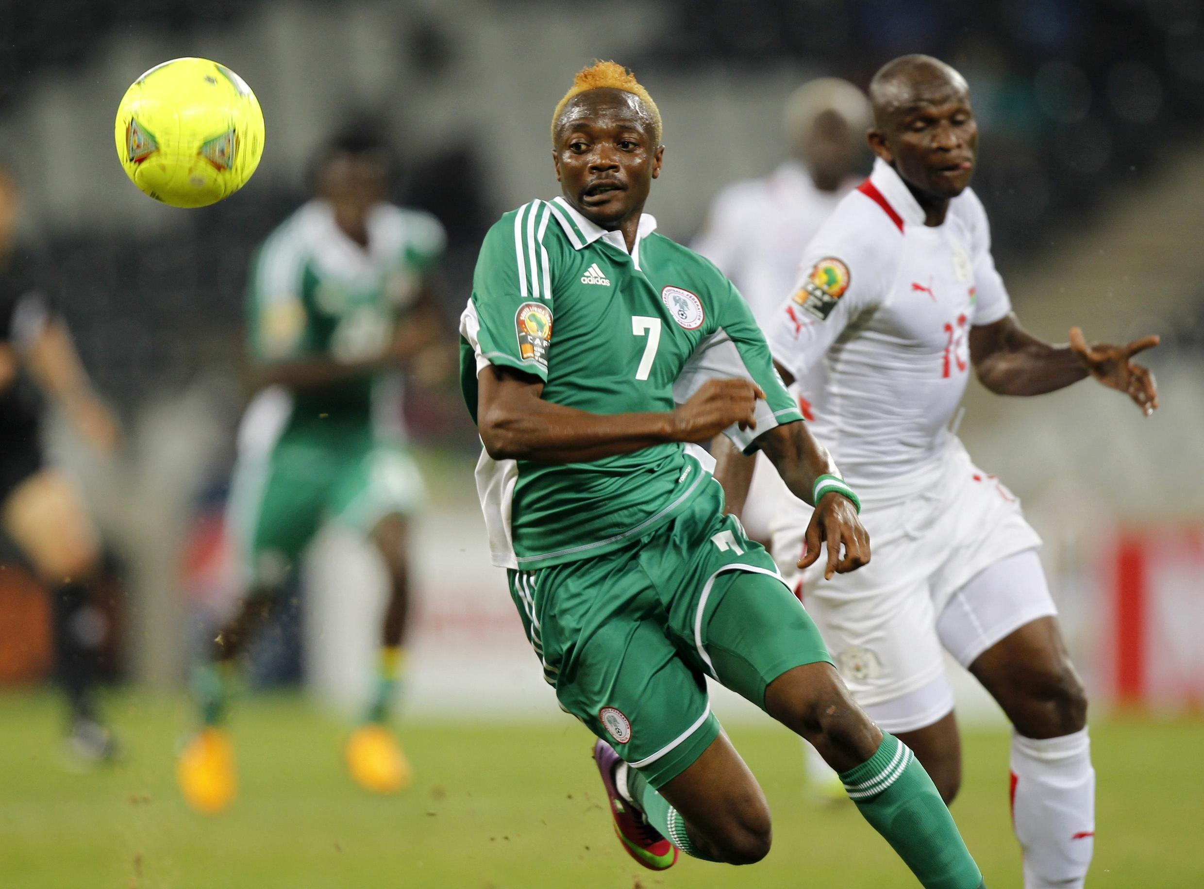 Nigeria's Ahmed Musa and Burkina Faso's Mady Panandetiguiri (R) during their match in Nelspruit, 21 January