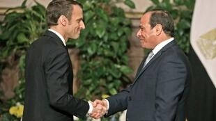 Stron handshake between French President Macron (L) and Egyptian President al-Sisi (R), an ally to France