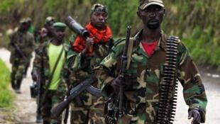 Wasu 'yan tawayen M23 na Jamahuriyar democradiyyar Congo a lokacin da suke ficewa birnin Goma