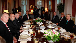 Hillary Clinton and Hamid Karzai at a dinner on Monday