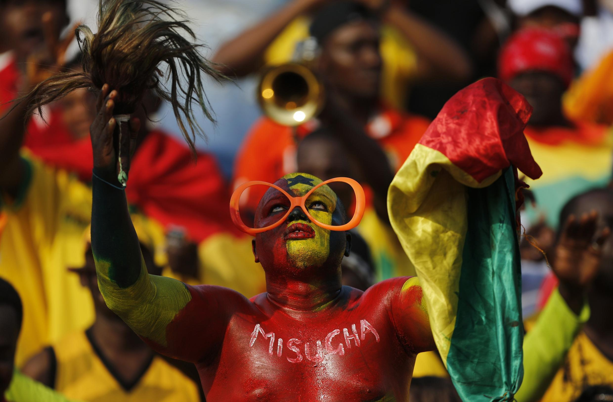 A Ghana fan cheers for the team during their match against Algeria  in Mongomo