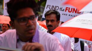 Une manifestation le 10 mai 2016 à New Delhi pour appeler la Chine, l'Allemagne et le Japon à intensifier leurs contributions au Fonds mondial de lutte contre le Sida, la tuberculose et le paludisme. (Photo d'illustration)