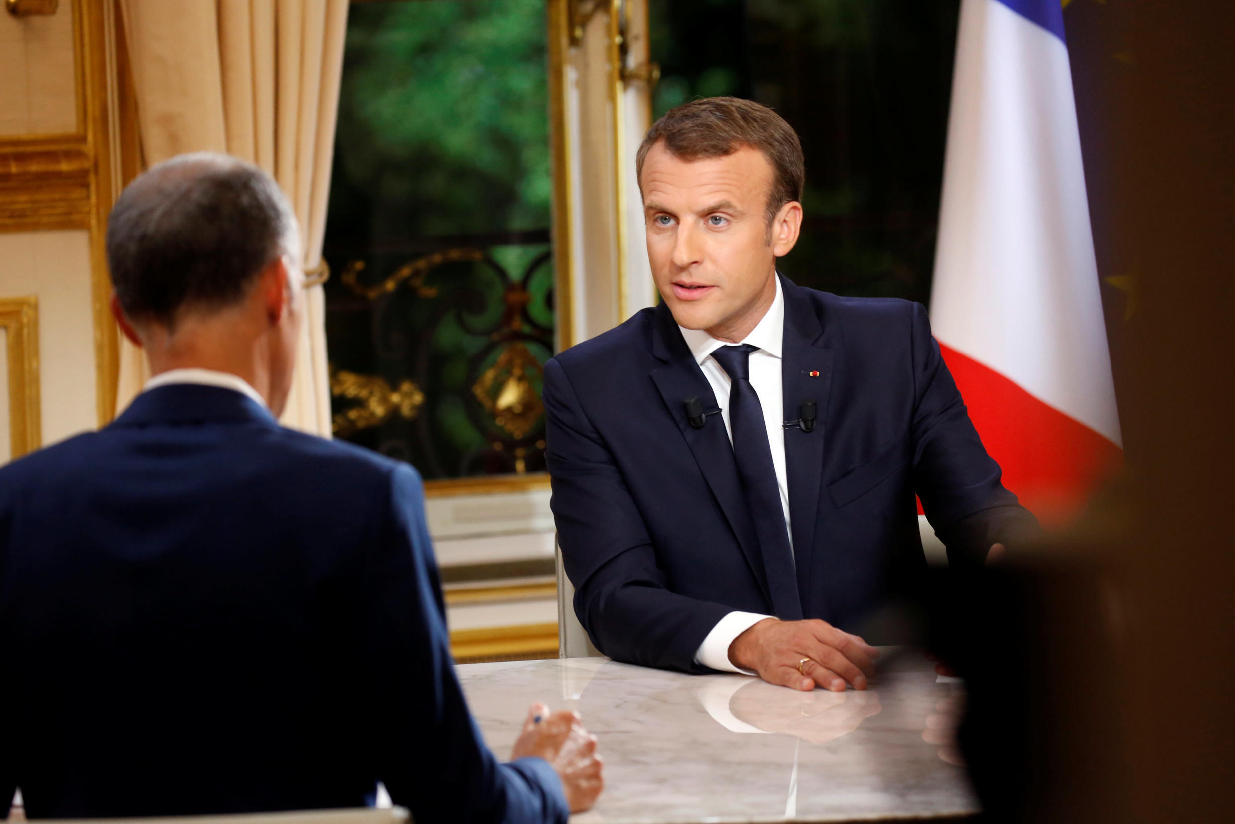 French President Emmanuel Macron is seen during his first long live television interview on prime time at the Elysee Palace in Paris, France, October 15, 2017.