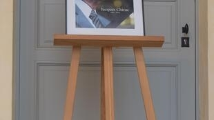 Photo of President Jacques Chirac on display at the ceremony, Les Invalides in Paris, September 29, 2019