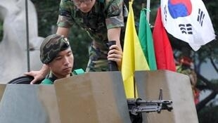 South Korean soldiers check equipment ahead of the start of the war games