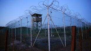 Chain link fence and concertina wire surrounds a deserted guard tower within Joint Task Force Guantanamo's Camp Delta at the U.S. Naval Base in Guantanamo Bay, Cuba March 21, 2016