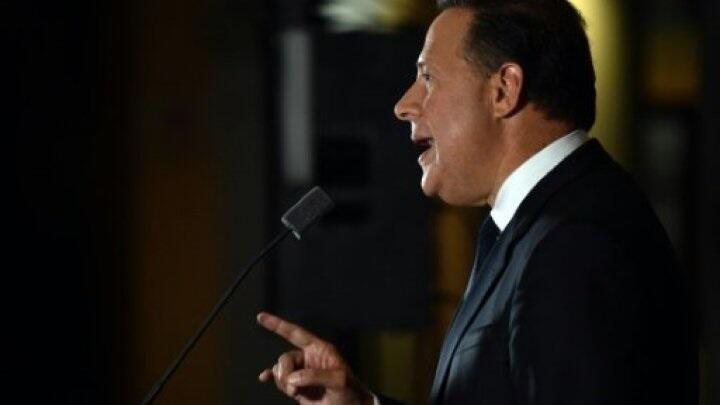 anama President Juan Carlos Varela delivers a speech at Bolivar Palace in Panama City on April 6, 2016.