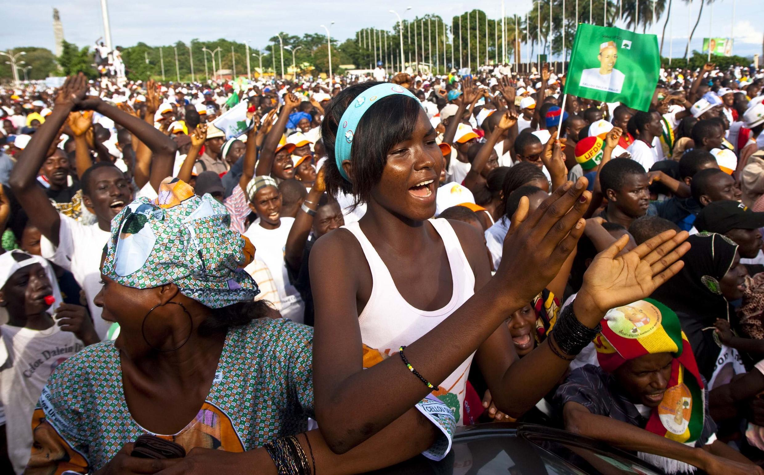 Supporters of the Union for the Democratic Forces of Guinea (UFDG) attend a presidential campaign rally in the capital Conakry