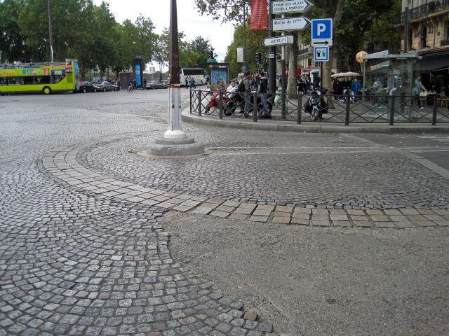 Paving stones mark the outline of the Bastille fortress, on the corner of the Place de la Bastille and the rue Sainte Antoine