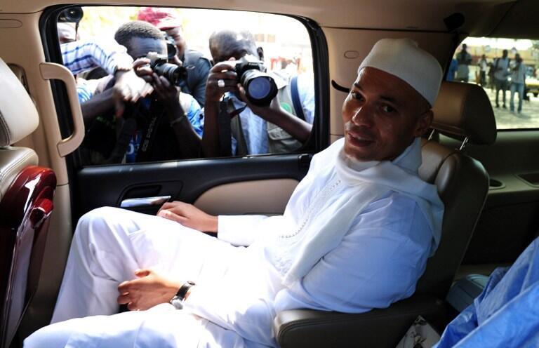 Karim Wade à son arrivée à l'audition devant la Cour de répression de l'enrichissement illicite à Dakar, le 15 mars 2013.