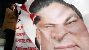 A poster of Mubarak at a press conference given by Kuwaiti lawyers defending him