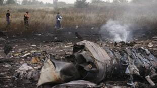 Wasu Tarkacen Jirgin Malaysia MH17 da ya fado a gabacin kasar Ukraine