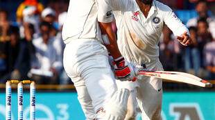 Cricket - India v New Zealand - Third Test cricket match - Holkar Cricket Stadium, Indore, India - 11/10/2016. India's Virat Kohli (R) celebrates with teammates after winning the match.