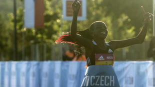 Peres Jepchirchir of Kenya crosses the finish line to win the women-only half marathon in a new record time